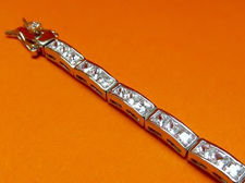 "Picture of ""Classic Channels of Zirconia"" tennis bracelet in sterling silver and channels of square cubic zirconia"