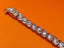 """Picture of """"Dashing Zirconia"""" tennis bracelet in sterling silver and round cubic zirconia with wave dashes"""