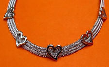 "Picture of ""Herringbone Heart"" set of necklace and bracelet entirely in Italian sterling silver, flat herringbone decorated with polished hearts"