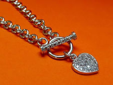 """Picture of """"Pavé heart"""" bracelet in sterling silver, rolo link chain with heart charm and toggle bar inlaid with cubic zirconia"""