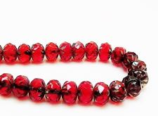 Picture of 7x10 mm, carved cruller beads, Czech, deep ruby red, transparent, picasso