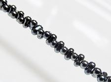 Picture of 2x4 mm, Japanese peanut-shaped seed beads, opaque, hematite grey, metallic